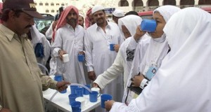 Musilm pilgrims drink holy water from the Zamzam s